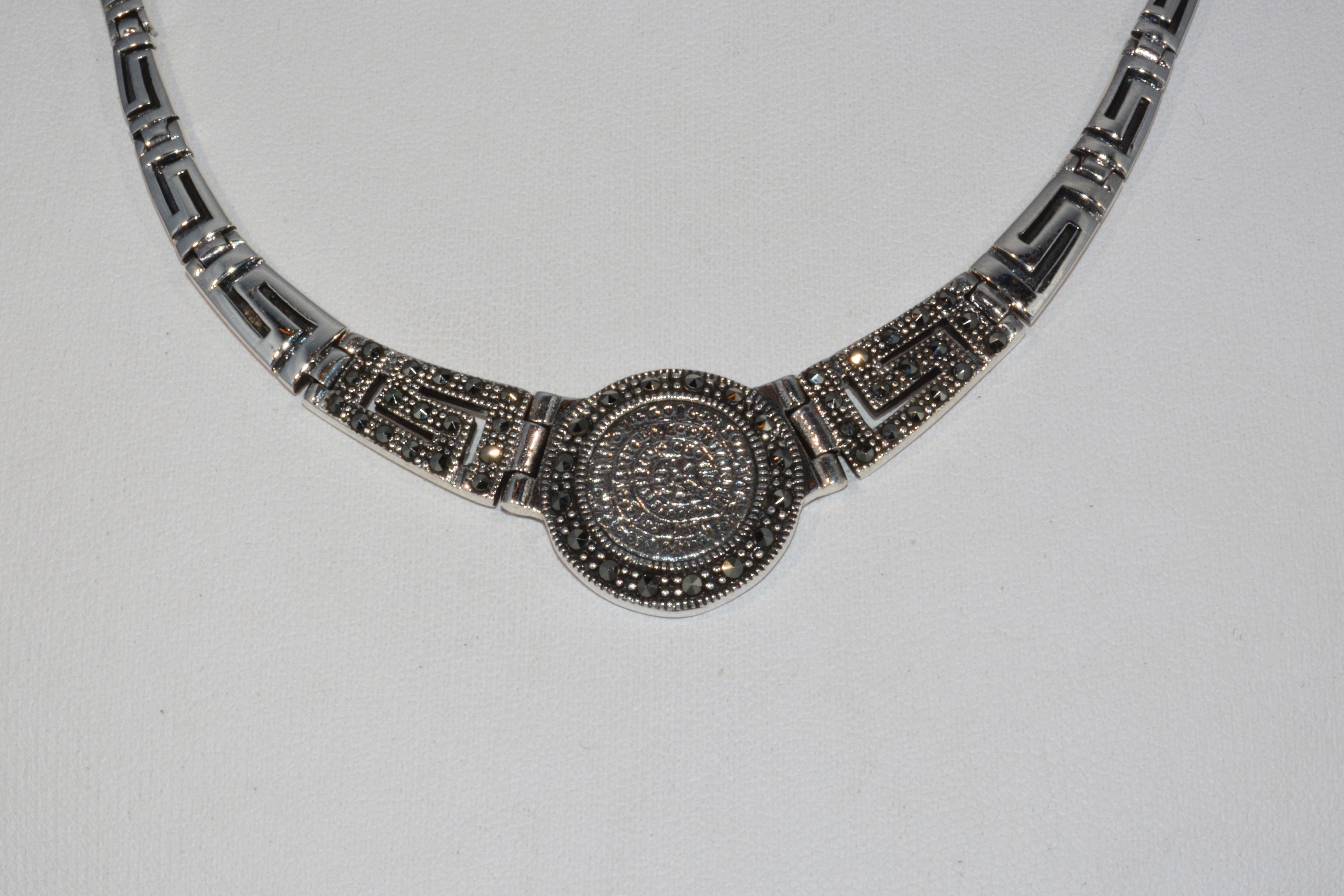 """Phaistos Disc Necklace"""